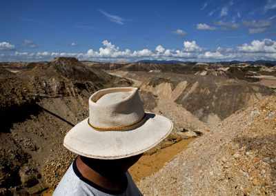 An owner of a legal gold mine oversees the land.
