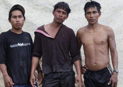 Illegal gold miners Dani (L) Armando, (C) and Marco at camp.